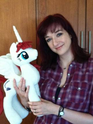 Lauren Faust, folding a plush toy of her Pony-persona